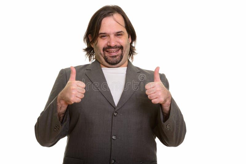 Το ευτυχές παχύ καυκάσιο χαμόγελο επιχειρηματιών και το δόσιμο φυλλομετρούν επάνω στοκ φωτογραφίες
