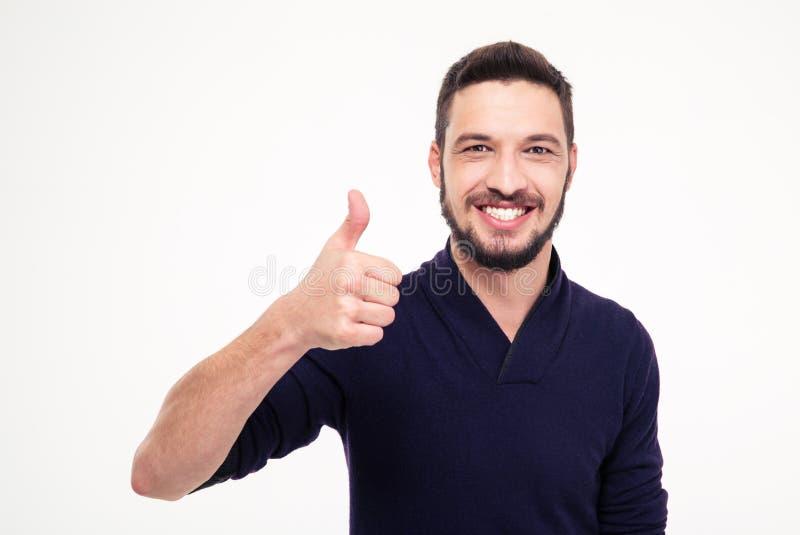 Το εύθυμο ελκυστικό γενειοφόρο άτομο που χαμογελά και που παρουσιάζει φυλλομετρεί επάνω στοκ φωτογραφίες με δικαίωμα ελεύθερης χρήσης