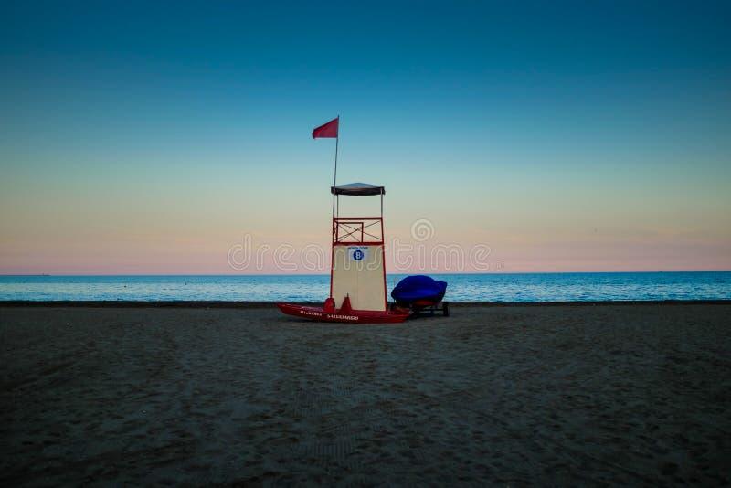 Το ηλιοβασίλεμα στη λιμνοθάλασσα είναι εδώ ο φάρος στο νησί Murano - τη Βενετία στοκ φωτογραφία με δικαίωμα ελεύθερης χρήσης