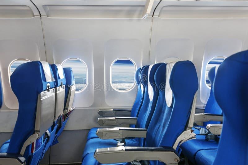 Το κάθισμα και τα παράθυρα αεροπλάνων στοκ φωτογραφία με δικαίωμα ελεύθερης χρήσης