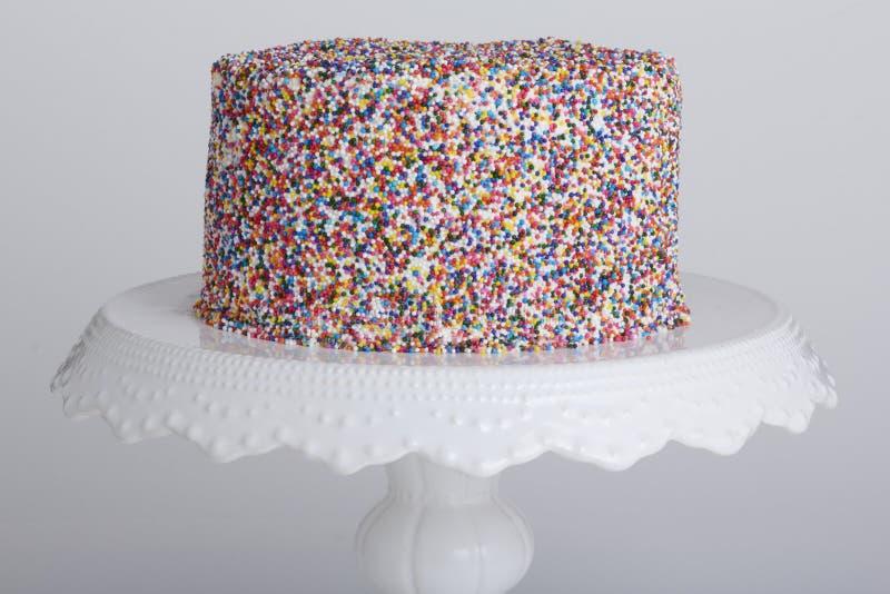 Το κέικ με ψεκάζει στοκ εικόνες