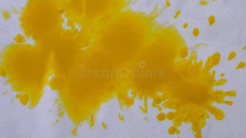 Το κίτρινο, ηλιόλουστο μελάνι, σταγονίδια χρωμάτων διαδίδει απόθεμα βίντεο