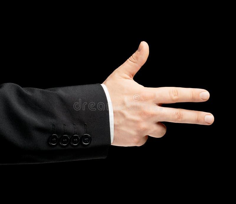 Το καυκάσιο αρσενικό παραδίδει ένα επιχειρησιακό κοστούμι που απομονώνεται στοκ εικόνα με δικαίωμα ελεύθερης χρήσης