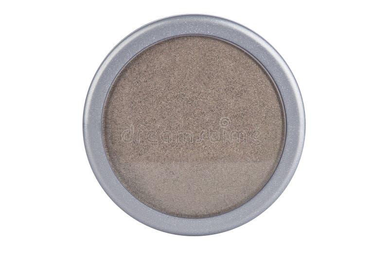Το καφετί χρώμα με ακτινοβολεί σκόνη σκιάς ματιών μορίων, στο στρογγυλό γκρίζο εμπορευματοκιβώτιο, προϊόν ομορφιάς που απομονώνετ στοκ φωτογραφία