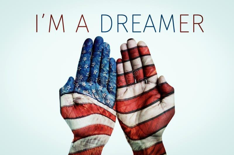 Το κείμενο Ι είναι ονειροπόλος και μια αμερικανική σημαία στοκ εικόνες