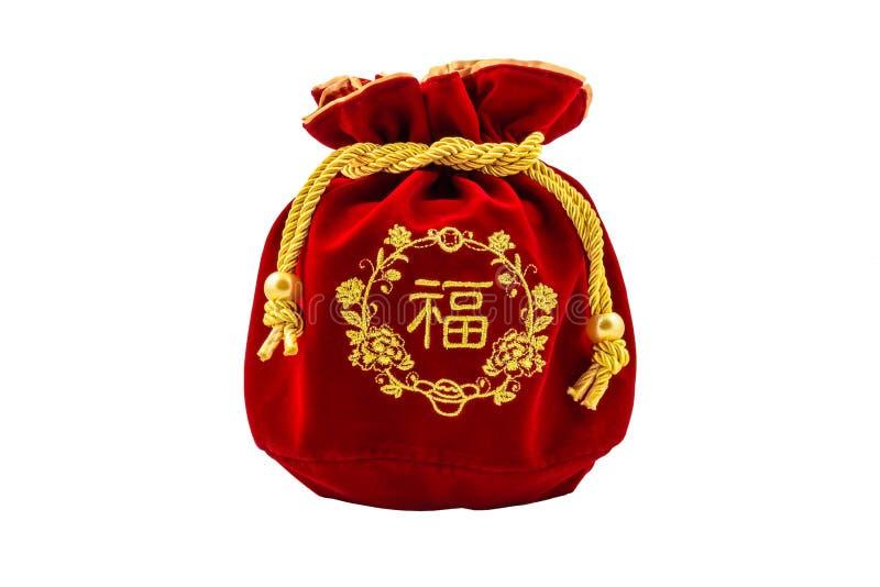 Το κινεζικό νέο κόκκινο ύφασμα ή το μετάξι έτους τοποθετεί σε σάκκο, ANG pow της τύχης isolat στοκ φωτογραφία