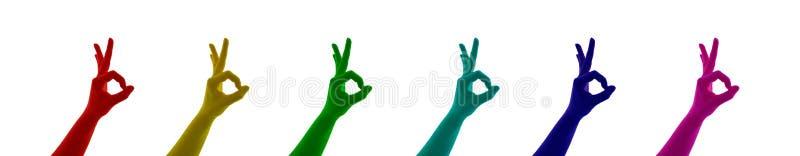 Το κολάζ του σημαδιού χεριών χρωμάτισε ΕΝΤΆΞΕΙ στο κόκκινο, κίτρινος, πράσινος, μπλε, κυανός, ρόδινος, magent ελεύθερη απεικόνιση δικαιώματος