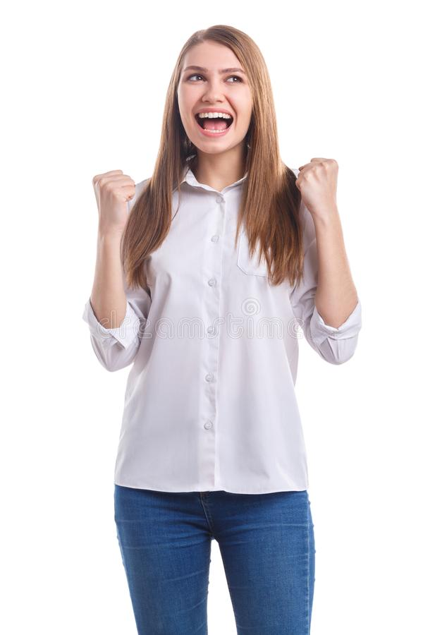 Το κορίτσι είναι πολύ ευχαριστημένο από την κλίση παραδίδει τις πυγμές σε ένα απομονωμένο λευκό υπόβαθρο στοκ φωτογραφία