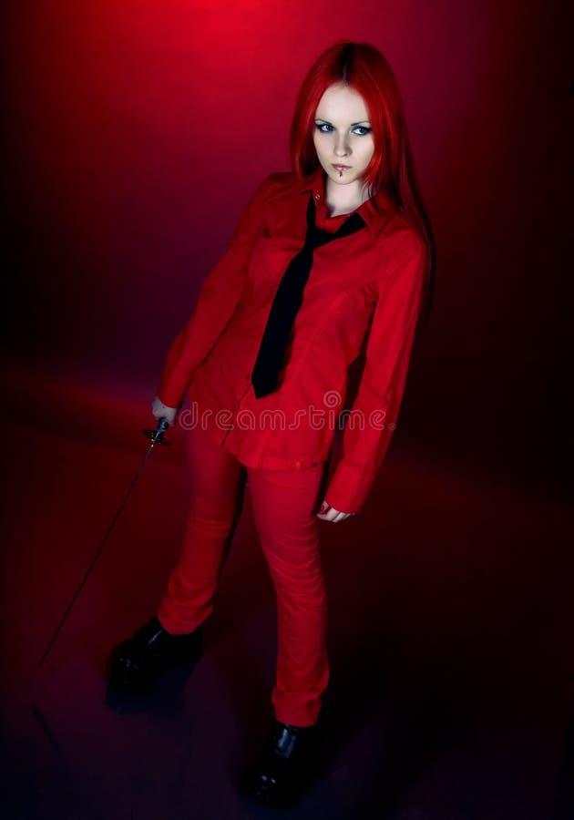 το κορίτσι ι ιαπωνικό ξίφο&sigm στοκ φωτογραφία με δικαίωμα ελεύθερης χρήσης
