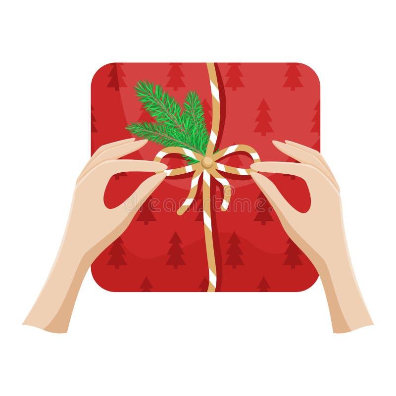 Το κορίτσι πακετάρει ένα χριστουγεννιάτικο δώρο και δένει ένα τόξο Χριστουγεννιάτικη απεικόνιση επίπεδου διανύσματος ελεύθερη απεικόνιση δικαιώματος