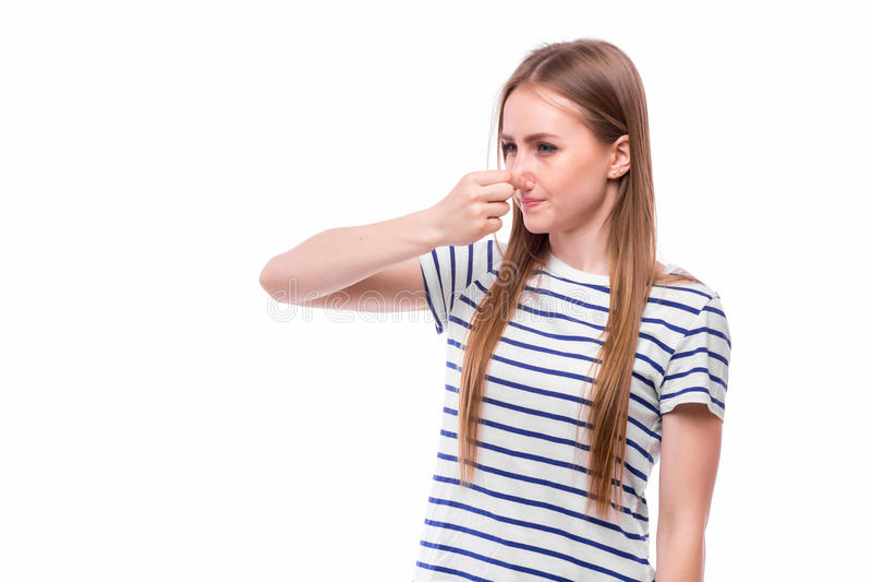 Το κορίτσι παρουσιάζει κακά smels στοκ φωτογραφία