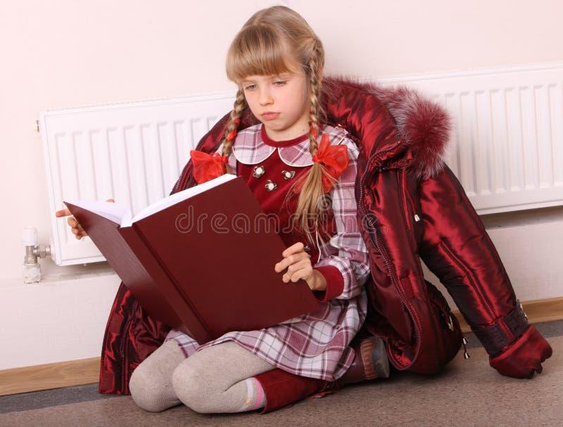 το κορίτσι πατωμάτων βιβλί& στοκ εικόνα