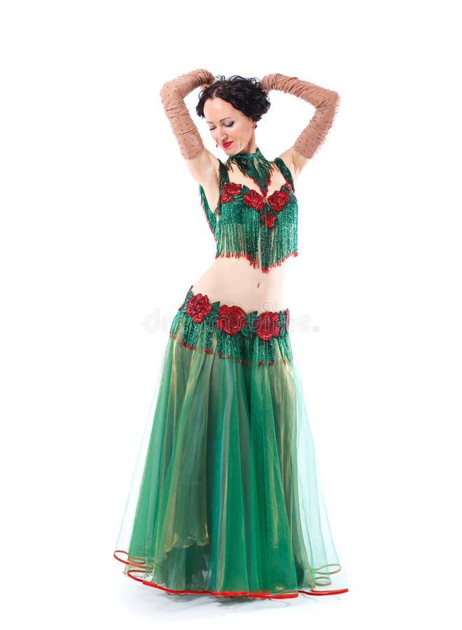 Το κορίτσι σε ένα πράσινο φόρεμα σταμάτησε στο χορό στοκ φωτογραφία με δικαίωμα ελεύθερης χρήσης