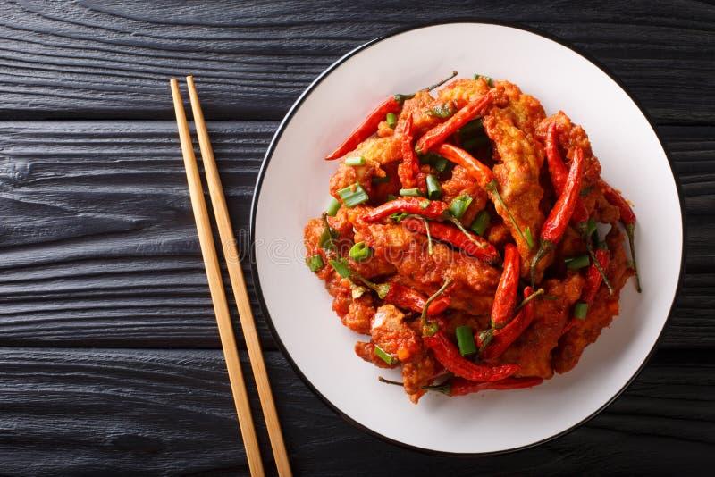 Το κοτόπουλο Schezwanήτο szechuan κοτόπουλοείναι ένα δημοφιλές ορεκτικό από την κινεζική κινηματογράφηση σε πρώτο πλάνο κουζίν στοκ εικόνα με δικαίωμα ελεύθερης χρήσης
