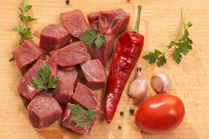 το κρέας προετοιμάζεται στοκ εικόνες