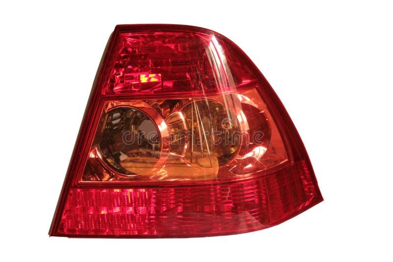 Το κόκκινο οπίσθιο φανάρι του αυτοκινήτου σε ένα άσπρο υπόβαθρο στοκ εικόνες