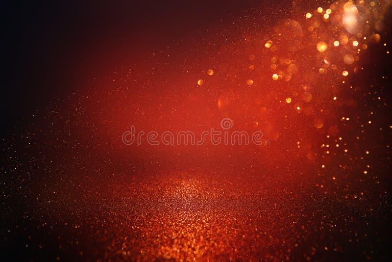 Το κόκκινο, ο Μαύρος και ο χρυσός ακτινοβολούν υπόβαθρο φω'των Defocused στοκ φωτογραφία με δικαίωμα ελεύθερης χρήσης