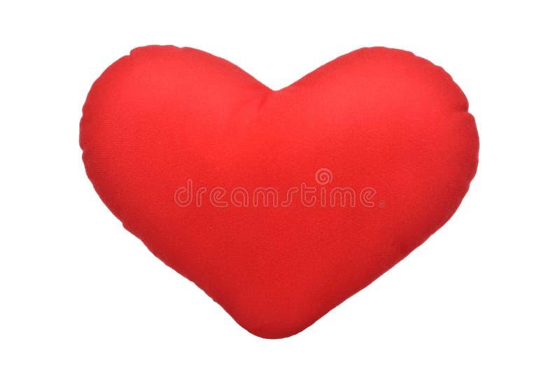 Το κόκκινο ρίχνει τη μορφή καρδιών μαξιλαριών στοκ φωτογραφίες