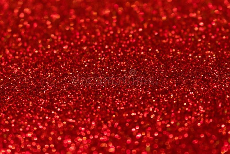 Το κόκκινο υπόβαθρο με το λαμπύρισμα ακτινοβολεί στοκ εικόνα με δικαίωμα ελεύθερης χρήσης