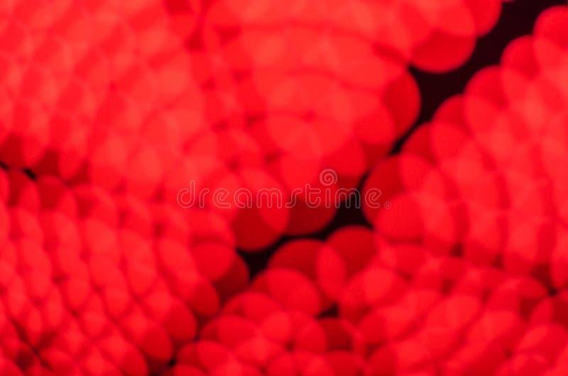 Το κόκκινο φως bokeh το υπόβαθρο στοκ εικόνα