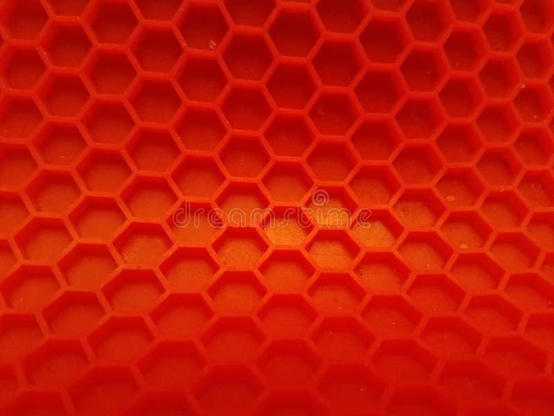 Το κόκκινο Hexagon σκηνικό με εξασθενίζει στοκ φωτογραφίες με δικαίωμα ελεύθερης χρήσης