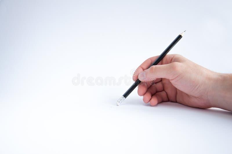 Το μαύρο μολύβι κρατά σε δεξή του σύρει στοκ φωτογραφία με δικαίωμα ελεύθερης χρήσης
