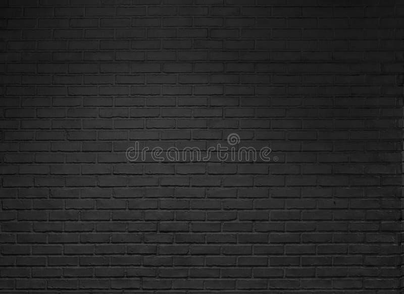 Το μαύρο υπόβαθρο τουβλότοιχος, σύσταση, οριζόντια, δημιουργεί ένα ελαφρύ σκοτάδι στοκ εικόνες