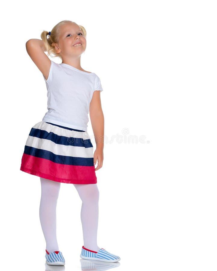 Το μικρό κορίτσι σκέφτεται στοκ φωτογραφία με δικαίωμα ελεύθερης χρήσης