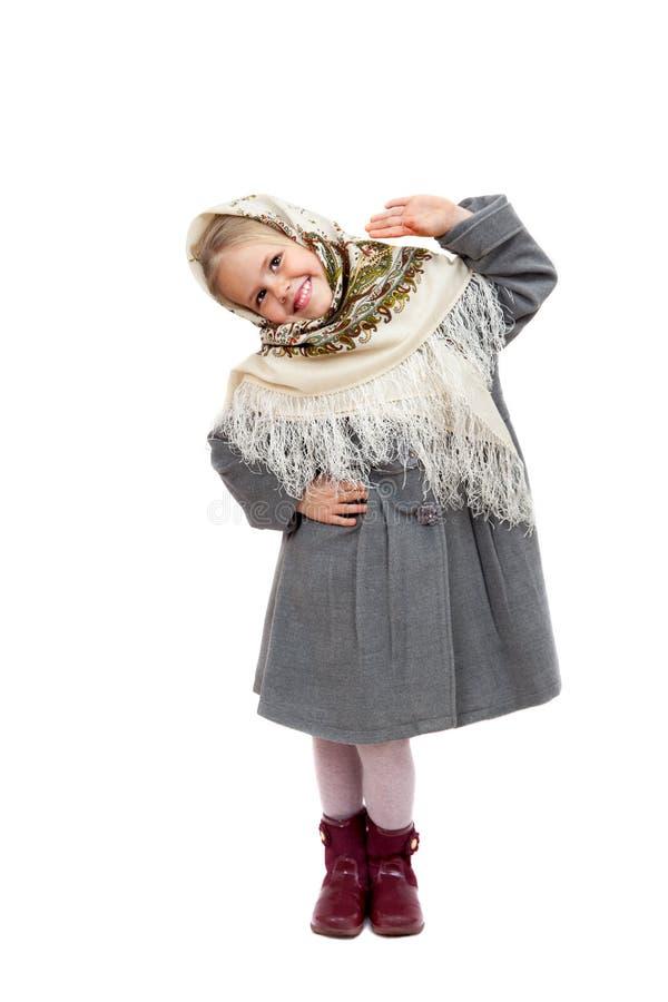 Το μικρό κορίτσι στα σλαβικά μαντίλι για το κεφάλι χορεύει στοκ φωτογραφίες με δικαίωμα ελεύθερης χρήσης