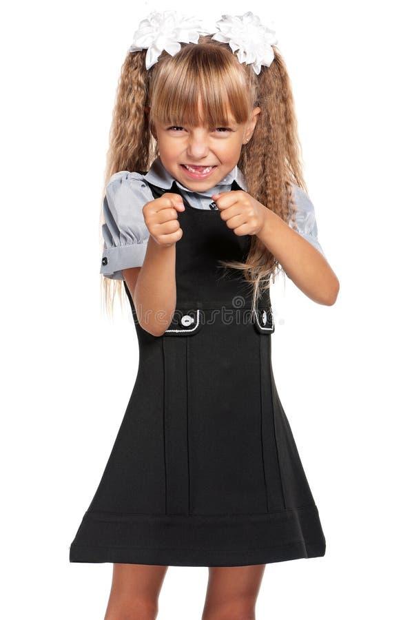 Το μικρό κορίτσι σφίγγει τις πυγμές της στοκ φωτογραφία με δικαίωμα ελεύθερης χρήσης