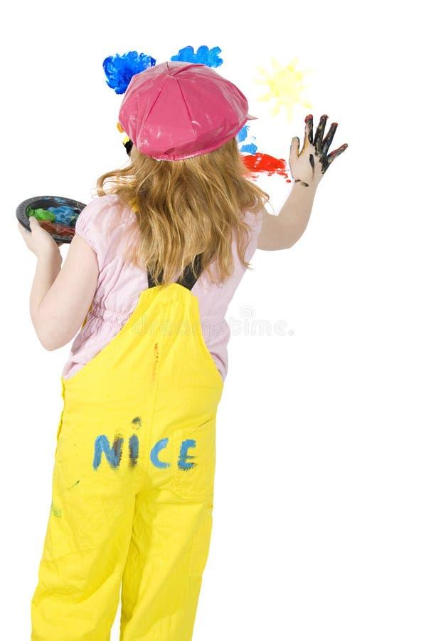 Το μικρό κορίτσι χρωματίζει στη Λευκή Βίβλο στοκ φωτογραφία