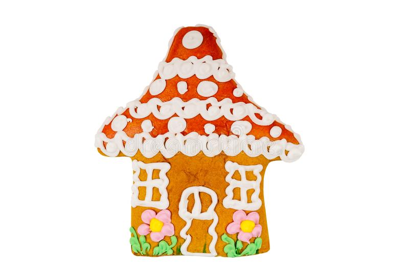 Το μπισκότο μελοψωμάτων που διαμορφώθηκε ως σπίτι και χρωμάτισε την τήξη για τις διακοπές Χριστουγέννων που απομονώθηκαν στο λευκ στοκ εικόνα με δικαίωμα ελεύθερης χρήσης