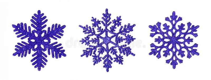 το μπλε σκοτάδι ακτινοβολεί snowflakes απεικόνιση αποθεμάτων