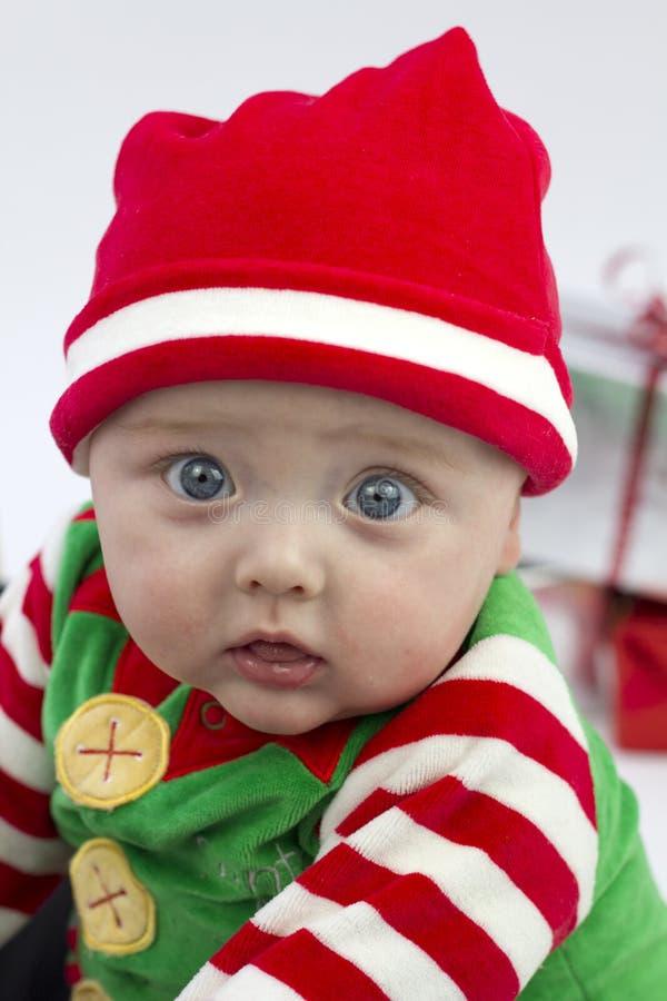 το μωρό εορταστικό παρου& στοκ φωτογραφία