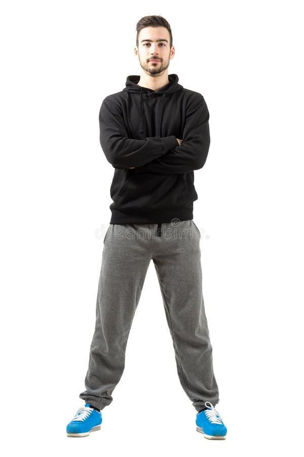 Το νέο αρσενικό με διπλωμένος παραδίδει sportswear στοκ φωτογραφία