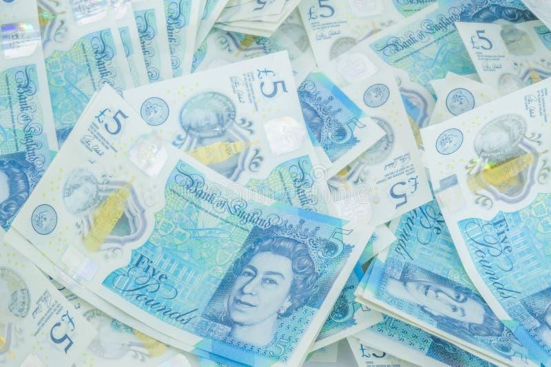 Το νέο βρετανικό πολυμερές σώμα σημείωση πέντε λιβρών που χαρακτηρίζει το ενισχυμένο counterfei στοκ φωτογραφίες με δικαίωμα ελεύθερης χρήσης
