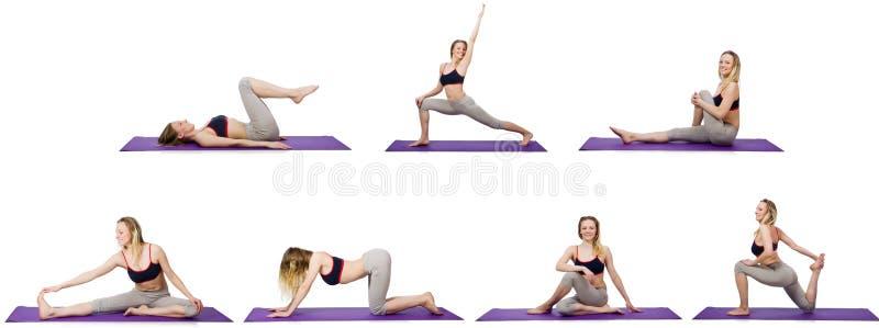 Το νέο θηλυκό που κάνει τις ασκήσεις στο λευκό στοκ εικόνα