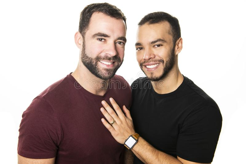 Το νέο ομοφυλόφιλο ζεύγος ομοφυλοφίλων αγαπά το ένα το άλλο σε ένα άσπρο υπόβαθρο στοκ εικόνα με δικαίωμα ελεύθερης χρήσης