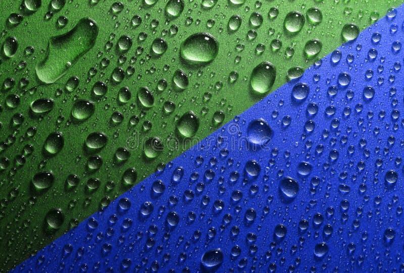 Το νερό ρίχνει την πράσινη μπλε σύσταση στοκ φωτογραφίες