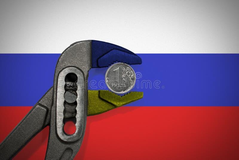 Το νόμισμα στη μέγγενη στο υπόβαθρο της σημαίας της Ρωσίας στοκ εικόνες με δικαίωμα ελεύθερης χρήσης
