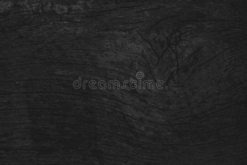 Το ξύλινο μαύρο επιτραπέζιο υπόβαθρο, σκοτεινή τοπ άποψη σύστασης, χωρίζει κατά διαστήματα το γκρίζο λ στοκ φωτογραφία