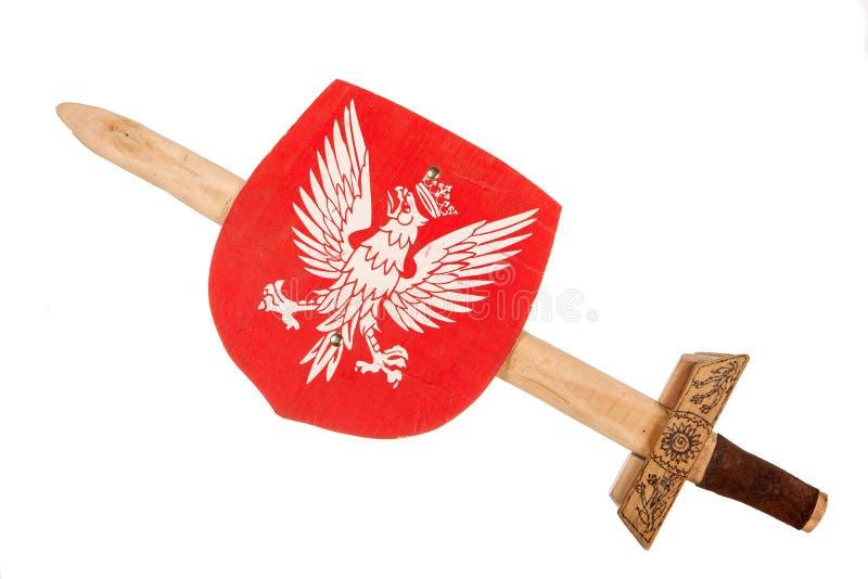 Το ξύλινο ξίφος παιχνιδιών και προστατεύει μια κάλυψη των όπλων της Πολωνίας στοκ εικόνες