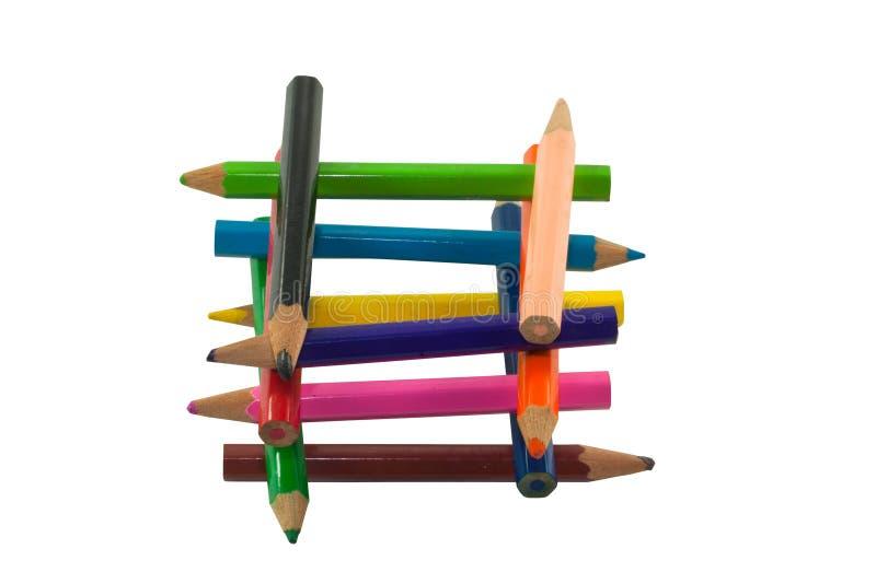 Το ξύλινο χρώμα μολυβιών κάνει όπως το γρίφο ή τον πύργο στοκ εικόνα