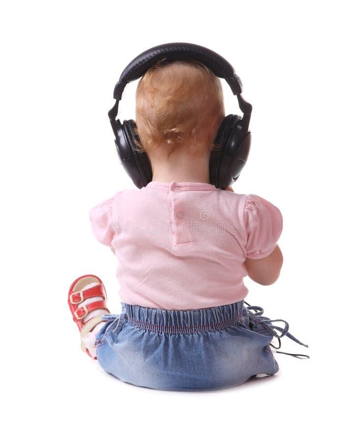 το παιδί ακούει μουσική  στοκ εικόνες με δικαίωμα ελεύθερης χρήσης