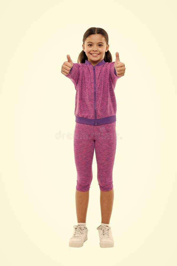 Το παιδί παρουσιάζει αντίχειρα Ευτυχής συνολικά ερωτευμένος τρυφερός κοριτσιών ή συστήνει ιδιαίτερα Αντίχειρας επάνω στο approvem στοκ φωτογραφία