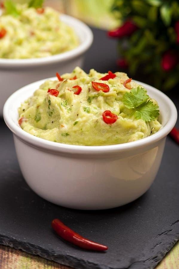 Το παραδοσιακό πιάτο της μεξικάνικης κουζίνας guacamole στοκ φωτογραφία με δικαίωμα ελεύθερης χρήσης