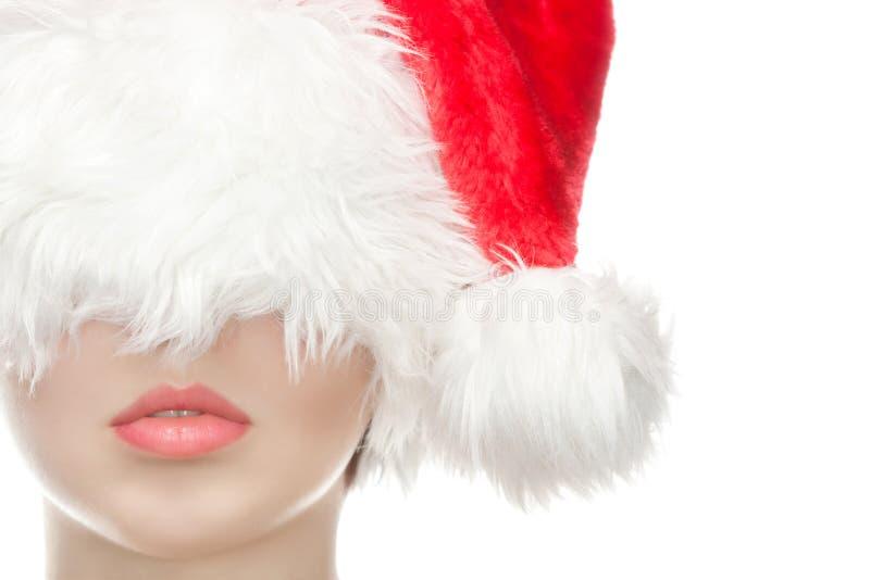 Το πορτρέτο ενός όμορφου κοριτσιού έντυσε στο καπέλο Άγιου Βασίλη, με μια όμορφη σύνθεση στοκ φωτογραφία