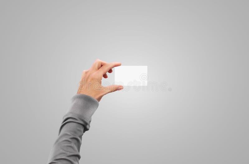 Το πουλόβερ παραδίδει τη χλεύη επαγγελματικών καρτών λαβής σακακιών πουλόβερ επάνω στοκ φωτογραφίες με δικαίωμα ελεύθερης χρήσης