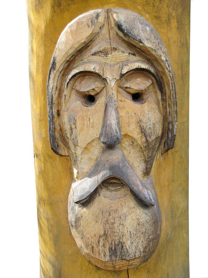 Το πρόσωπο ενός σοφού ηληκιωμένου φιαγμένου από ξύλο που απομονώνεται στο άσπρο υπόβαθρο στοκ φωτογραφία με δικαίωμα ελεύθερης χρήσης