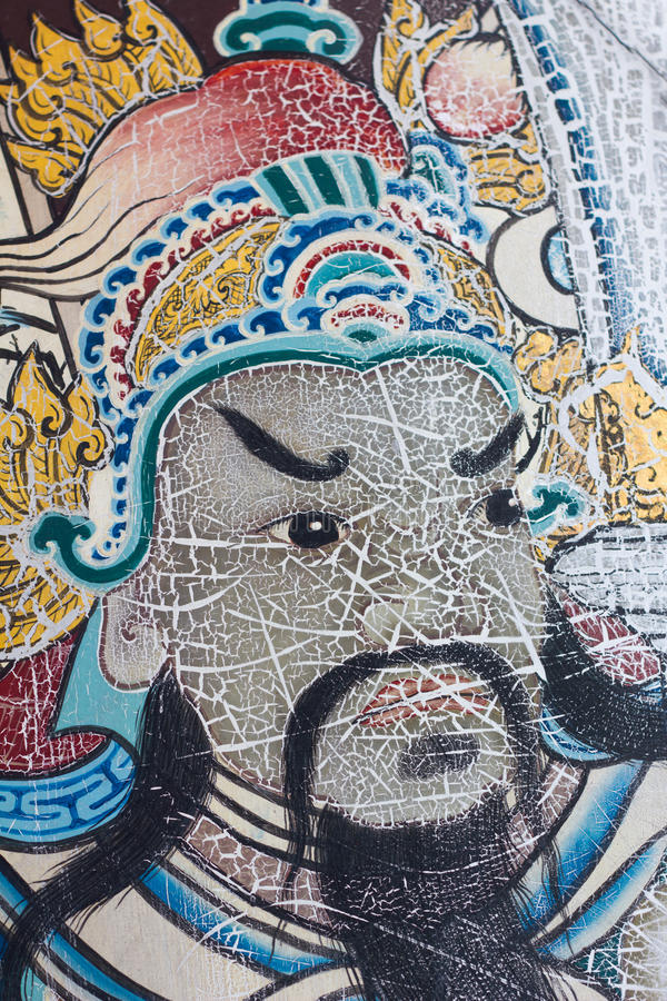 Το πρόσωπο ζωγραφικής του αρχαίου ασιατικού πολεμιστή σε μια πόρτα σε Wat Pho είναι τ στοκ εικόνες